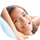 woman relaxed on couch smiling