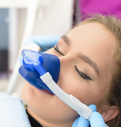 Woman with nitrous oxide mask