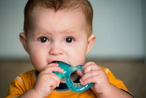 Baby chewing on pacifier